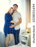man and a pregnant young woman... | Shutterstock . vector #1028031694