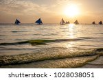 wind boat at the boracay island ... | Shutterstock . vector #1028038051