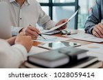 start up partners are working... | Shutterstock . vector #1028059414