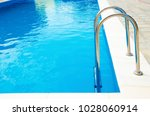 pool stairs with blue water | Shutterstock . vector #1028060914