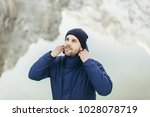 a man standing near lake in... | Shutterstock . vector #1028078719