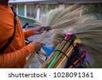holding a colourful broom grass ... | Shutterstock . vector #1028091361