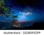 milky way over pine trees  phu... | Shutterstock . vector #1028093299