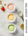 top view of ice cream in white... | Shutterstock . vector #1028097385