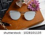 eyewear sunglasses photography | Shutterstock . vector #1028101135
