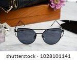 eyewear sunglasses photography | Shutterstock . vector #1028101141