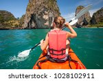 women are kayaking in the open... | Shutterstock . vector #1028102911