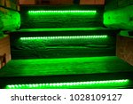 steps of a wooden staircase in... | Shutterstock . vector #1028109127