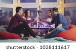 group of friends are clinking... | Shutterstock . vector #1028111617