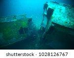 shipwreck  diving on a sunken... | Shutterstock . vector #1028126767