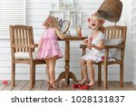 two little girls play in the... | Shutterstock . vector #1028131837