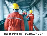 workers  helmets at the factory ... | Shutterstock . vector #1028134267