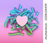 Small photo of the heart on rainbow bubble gum. metaphor. non-traditional orientation symbol. gradient purple, blue and pink colors. creative concept . minimal. symbolism