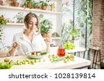 young woman eating healthy food ... | Shutterstock . vector #1028139814