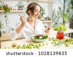 young woman eating healthy food ...