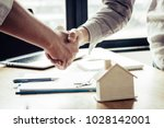 successful agreement   estate... | Shutterstock . vector #1028142001