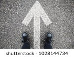 male feet in blue jeans and... | Shutterstock . vector #1028144734