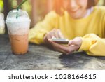 woman use of cellphone | Shutterstock . vector #1028164615