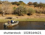 safari tourist boat approaching ... | Shutterstock . vector #1028164621