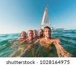 happy friends taking a selfie... | Shutterstock . vector #1028164975
