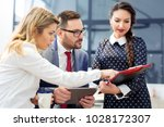group of business people... | Shutterstock . vector #1028172307