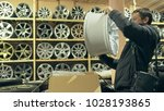 the man buys alloy wheels in... | Shutterstock . vector #1028193865
