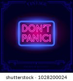 don't panic neon light sign.... | Shutterstock .eps vector #1028200024