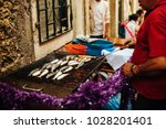 grilled sardines during the... | Shutterstock . vector #1028201401