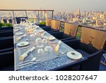 table setting on roof top... | Shutterstock . vector #1028207647