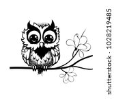 owl sitting on a branch of a... | Shutterstock .eps vector #1028219485
