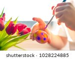 child's hands with a brush...   Shutterstock . vector #1028224885