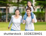 cute asian girl on neck parents ... | Shutterstock . vector #1028228401