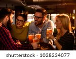 friends in the pub. drinking... | Shutterstock . vector #1028234077