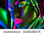 disco dancer in neon light.... | Shutterstock . vector #1028238274
