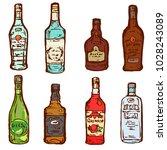 glass bottles alcohol drinks...   Shutterstock .eps vector #1028243089