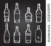glass bottles alcohol drinks... | Shutterstock .eps vector #1028243095