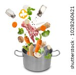 stainless steel pot with flying ... | Shutterstock . vector #1028260621