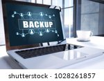 backup text on modern laptop... | Shutterstock . vector #1028261857