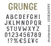 vector grunge textured font.... | Shutterstock .eps vector #1028265595