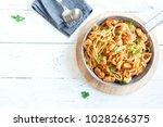 spaghetti pasta in tomato sauce ... | Shutterstock . vector #1028266375