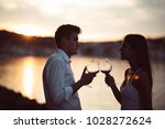 two young people at the beach... | Shutterstock . vector #1028272624