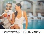 loving couple spending vacation ... | Shutterstock . vector #1028275897