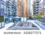 modern glass skyscrapers... | Shutterstock . vector #1028277271