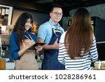 young asian barista taking... | Shutterstock . vector #1028286961