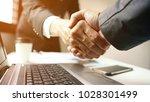 businessman hand shake ... | Shutterstock . vector #1028301499