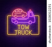 tow truck neon sign  bright... | Shutterstock .eps vector #1028312251