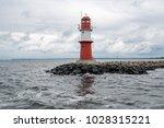 lighthouse at port entrance | Shutterstock . vector #1028315221