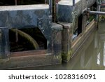 Small photo of The heavy and ancient lock gates allow and deny the water its movement