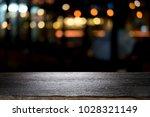 empty wooden table platform and ... | Shutterstock . vector #1028321149