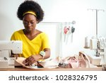 african seamstress sews clothes.... | Shutterstock . vector #1028326795